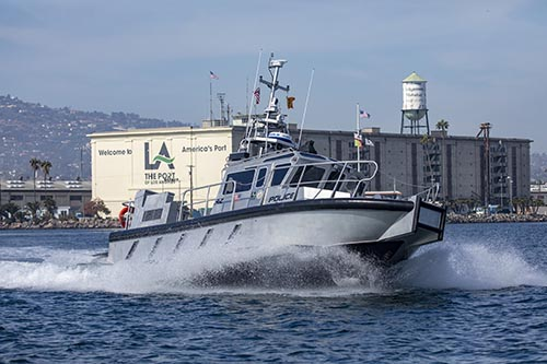 Police Boat in front of Warehouse One